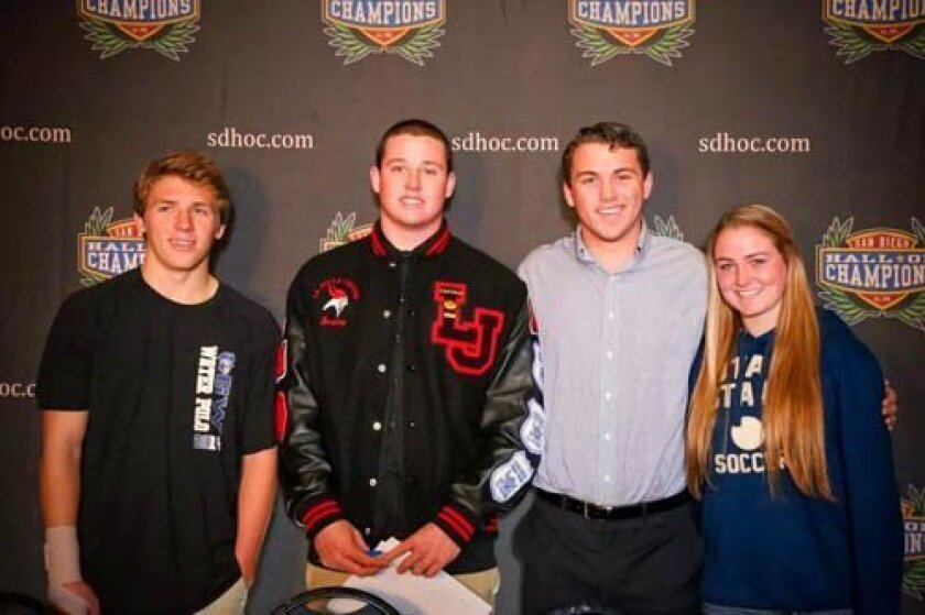 La Jolla student-athletes Duke Becker, Justin Cook, Ian Beed and Rachel Carroll sign letters of intent during the 2014 San Diego Signing Day. Courtesy