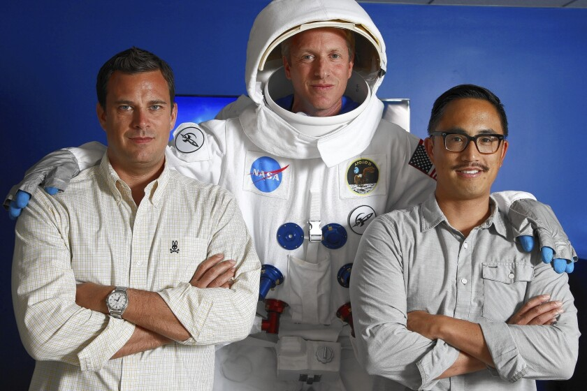 AdColony's top managers -- Chief Revenue Officer Mike Owen, left, Chief Executive Will Kassoy and Nikao Yang, a senior vice president -- at the company's Los Angeles offices. Kassoy wears a spacesuit to symbolize the heights to which AdColony aspires in mobile advertising.