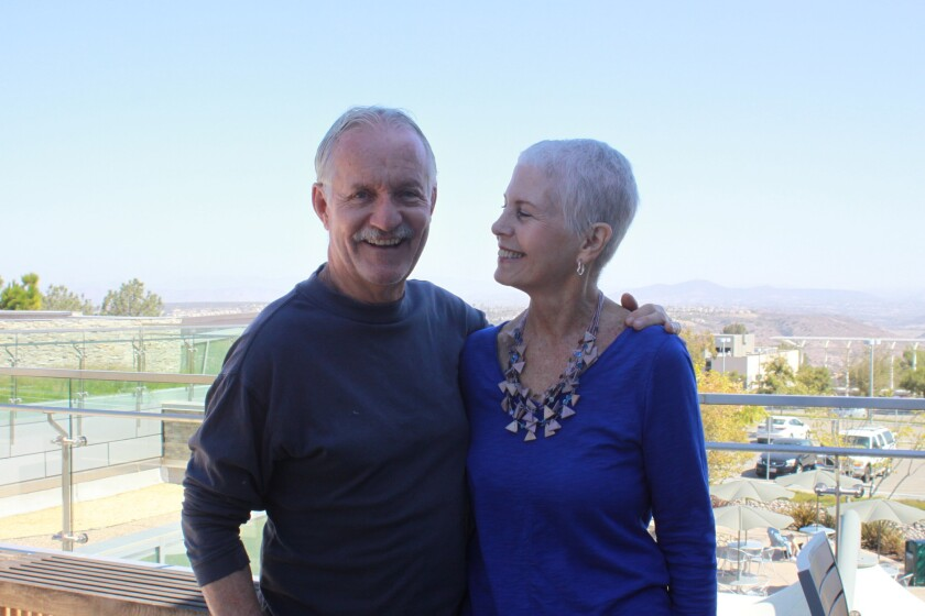Janet Chelberg-Burgess with her husband John, who she calls 'My Rock'