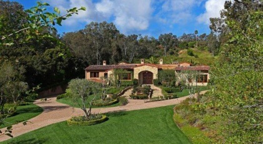 The Weissman residence in Rancho Santa Fe's Covenant. Below are photos taken at the home in the Covenant and the home in the Bridges.