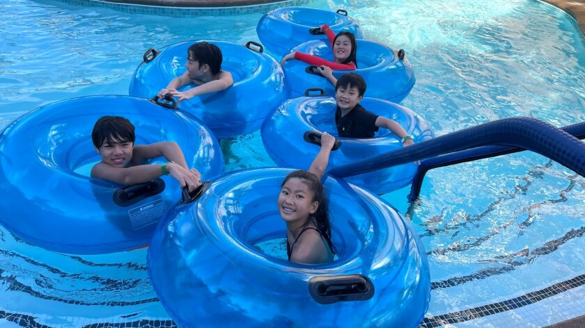 The Kurima children and friends in the lazy river at the Hyatt Hotel, November 23, 2020.