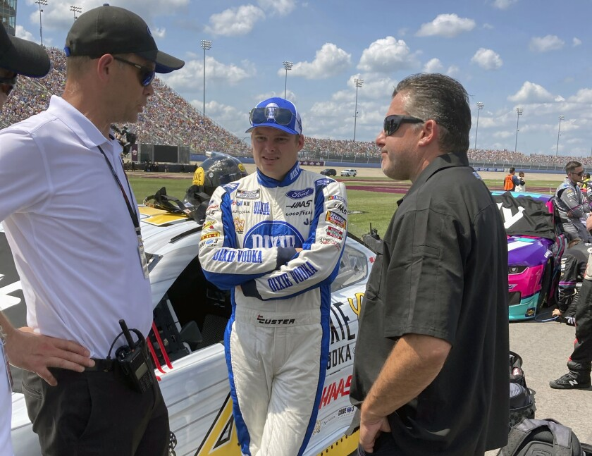 Tony Stewart, right, speaks to Mark Rushbrook, left, Ford Performance Motorsports Global Director, and NASCAR driver Cole Custer before a NASCAR Cup Series race at Nashville Speedway in Lebanon, Tenn., Sunday, June 20, 2021. Tony Stewart attended his first Cup race since the start of the pandemic and his trip to Nashville Superspeedway was rewarded when a pair of Stewart-Haas Racing drivers scored top-five finishes.(AP Photo/Jenna Fryer)