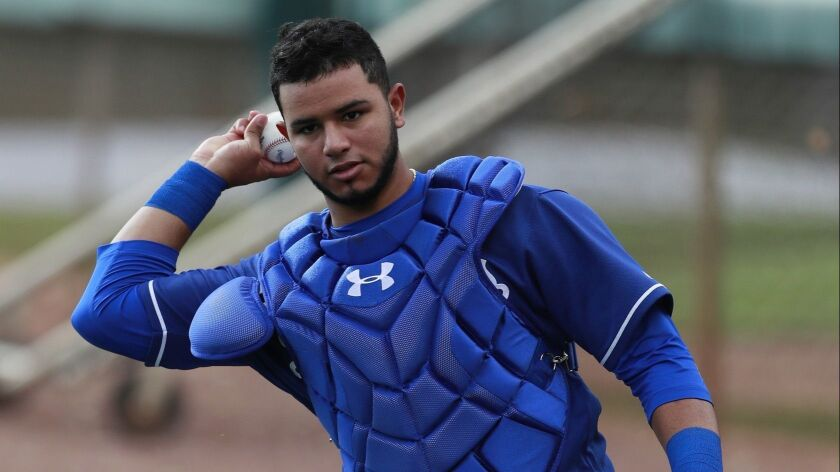 Dodgers catcher Keibert Ruiz participates in a drill at the team's spring training baseball facility in Phoenix on Monday.