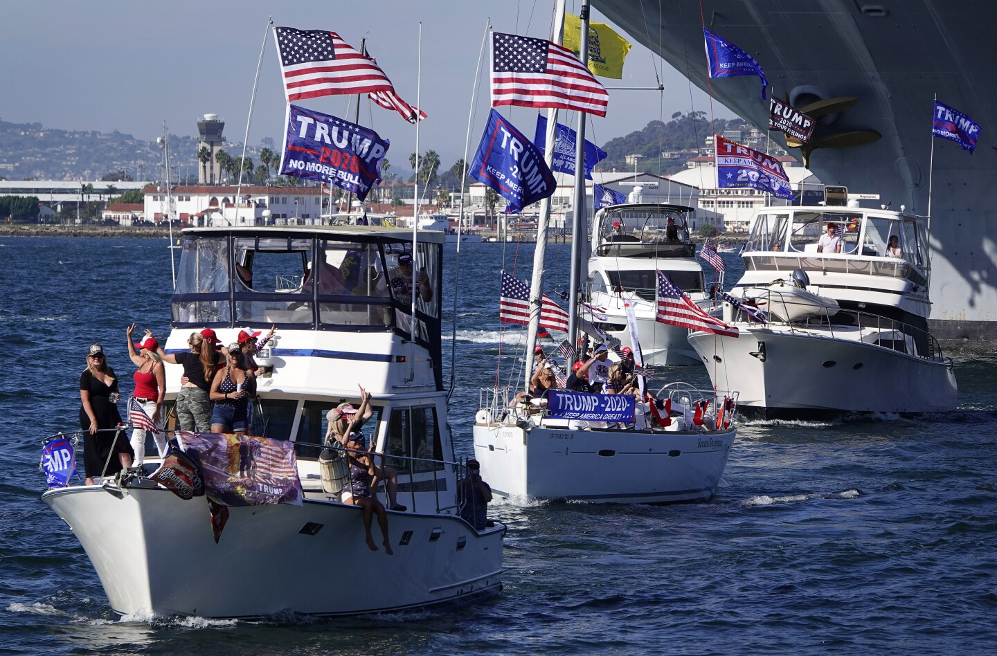 People show their support for President Donald Trump during a Trump Boat Parade in San Diego Bay.