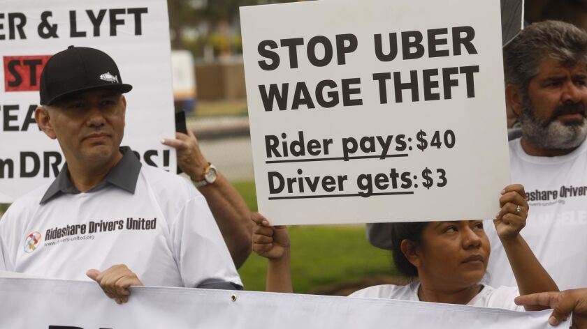Uber and Lyft drivers protest for better wages near LAX