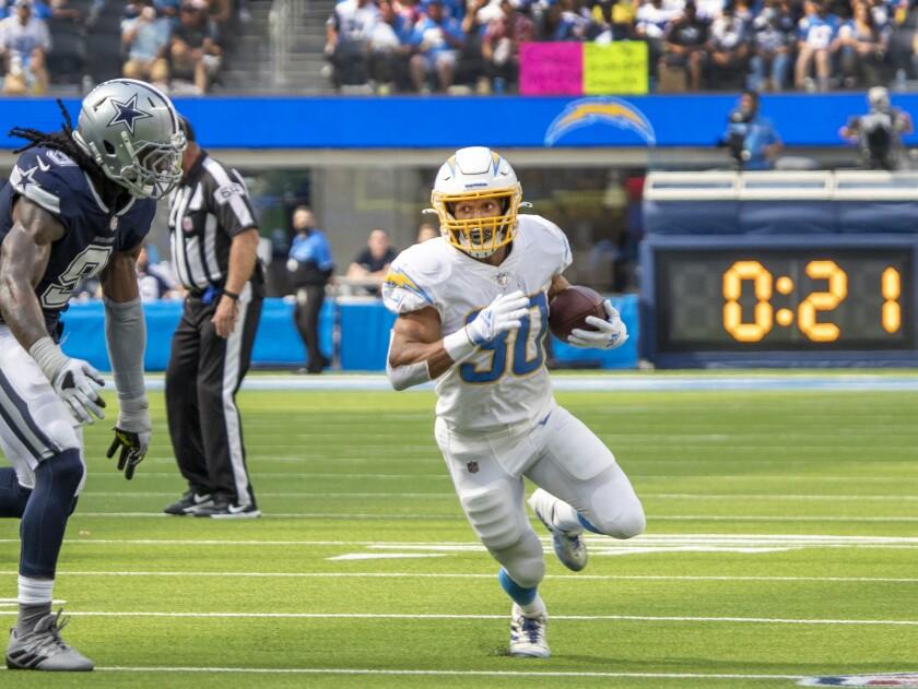 Chargers running back Austin Ekeler gains yardage against the Cowboys.
