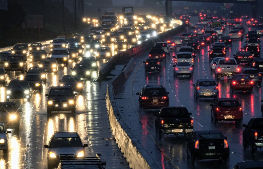 In this Jan. 12, 2017 file photo, early morning rush hour traffic crawls along the Hollywood Freeway toward downtown Los Angeles. One promise of ride-hailing companies was a drop in the number of cars in urban areas and an easing of clogged city streets. But a survey by an urban planning group suggests the opposite: That ride-hailing companies may be pulling riders off buses, subways and bicycles and putting them in cars.