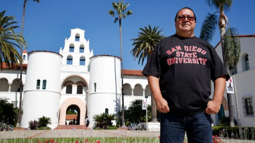 American Indian Studies professor Ozzie Monge, standing outside the mission-inspired Hepner Hall at San Diego State University, is renewing a call for the school to change its Aztec mascot, which he said is racist and causes historical misconceptions.