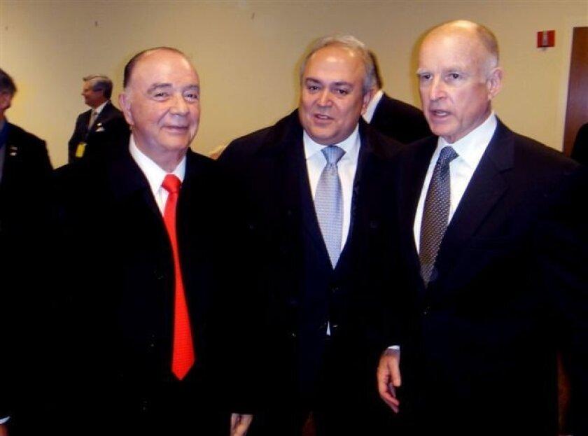 Tijuana Mayor Carlos Bustamante, left, and Baja California Gov. Jose Guadalupe Osuna Millan, center, joined California Gov. Jerry Brown in Sacramento at his inauguration last January.