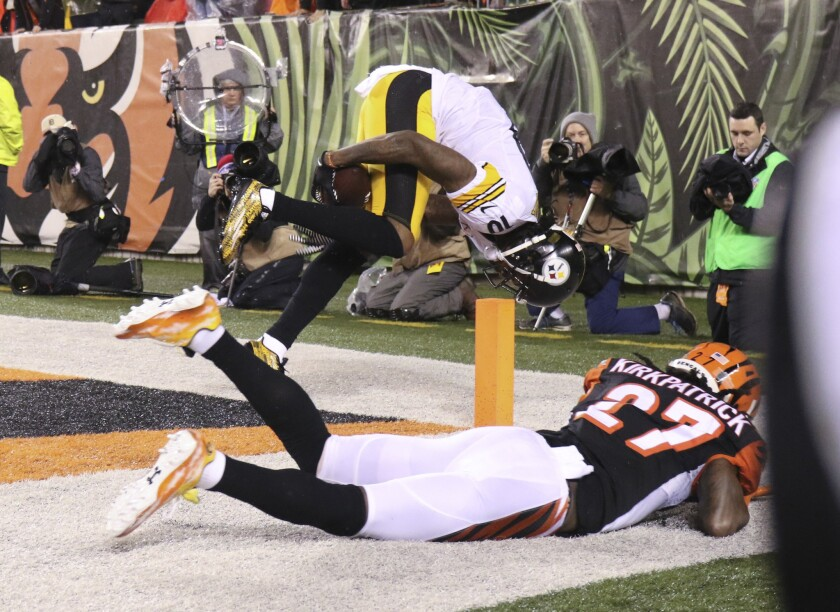 Steelers escape with wild-card win, 18-16, as Bengals lose control