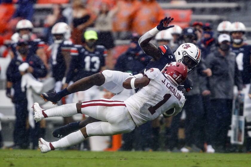 Auburn running back Tank Bigsby (4) is tacked by Arkansas defensive back Jalen Catalon (1) as he carries the ball during the first quarter of an NCAA college football game on Saturday, Oct. 10, 2020, in Auburn, Ala.. (AP Photo/Butch Dill)