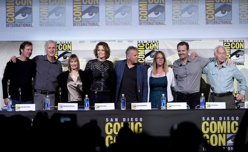 "Bill Paxton, James Cameron, Gale Anne Hurd, Sigourney Weaver, Paul Reiser, Carrie Henn, Michael Biehn, and Lance Henriksen attend the ""Aliens: 30th Anniversary"" panel during Comic-Con 2016."