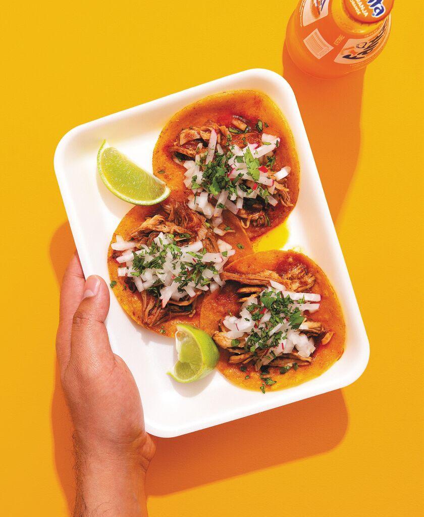 Chile sauce-braised pork sits atop crispy fried tortillas in Esteban Castillo's take on tacos Tuxpeños.