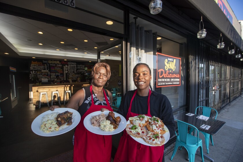 Tina McKenzie, right, and her mother, Dorla De Costa, aim to put Belizean food and culture on the map at their restaurant No Reservation L.A. in Little Ethiopia.