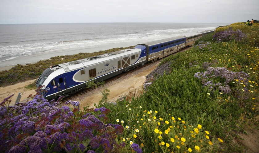 An Amtrak train in May on the bluffs in Del Mar, one of three areas North County Transit District plans to install fencing.