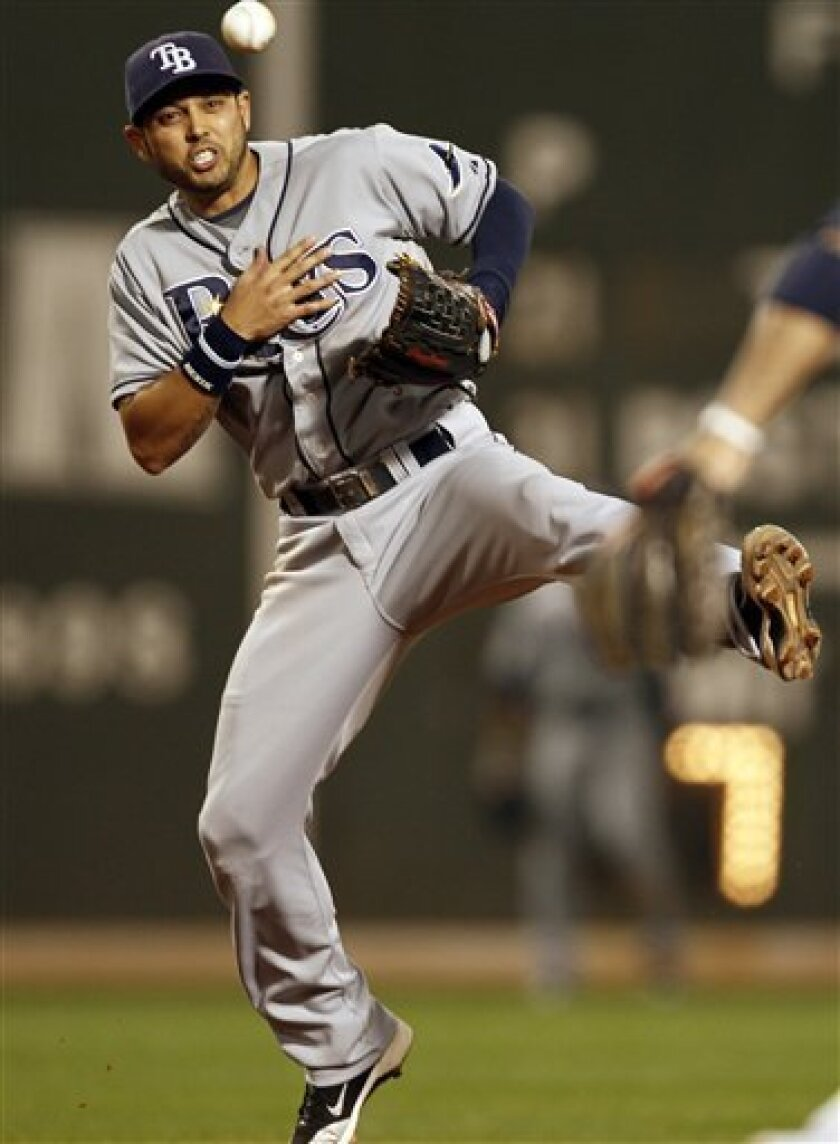 Tampa Bay Rays shortstop Jason Bartlett, shown in September 2010 game at Boston, is apparently headed to the Padres. (AP Photo/Winslow Townson)