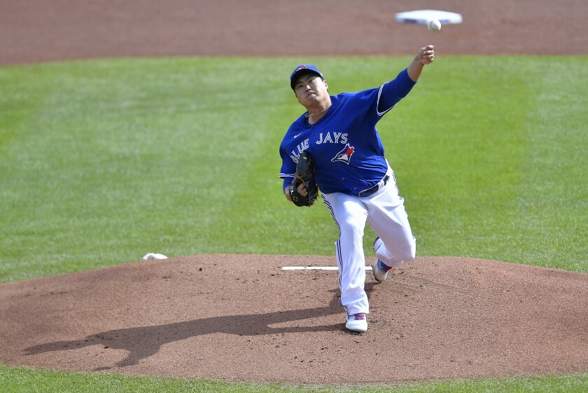 Toronto Blue Jays starting pitcher Hyun Jin Ryu throws to a New York Mets batter during the first inning of a baseball game in Buffalo, N.Y., Sunday, Sept. 13, 2020. (AP Photo/Adrian Kraus)