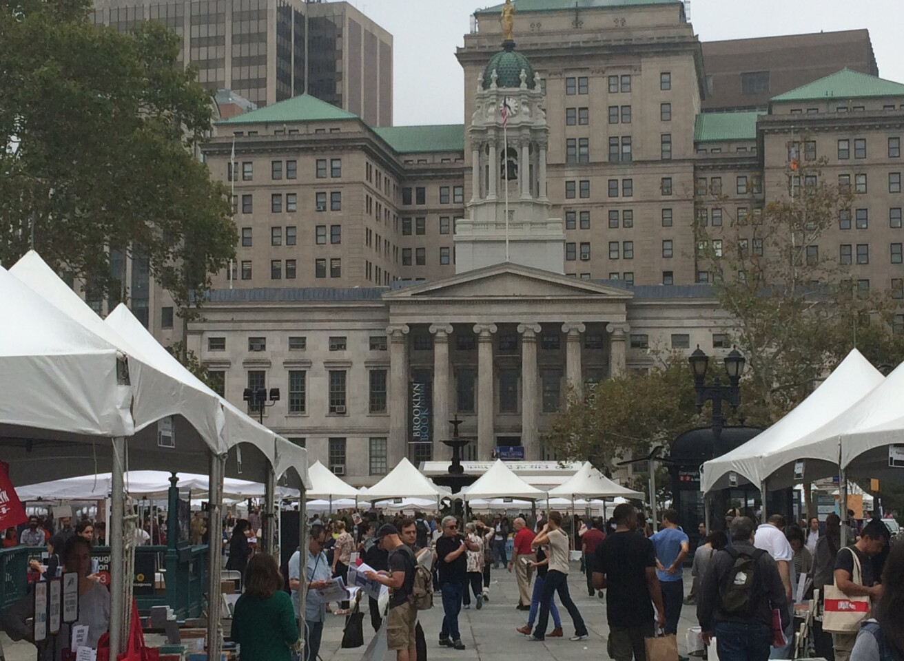 Brooklyn Borough Hall can be seen behind the stalls of Sunday's Brooklyn Book Festival.