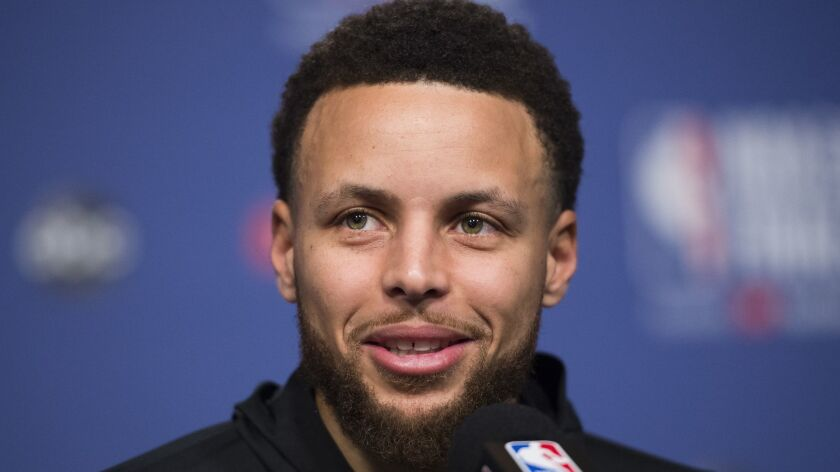 FILE - In this May 29, 2019 file photo, Golden State Warriors basketball guard Stephen Curry speaks