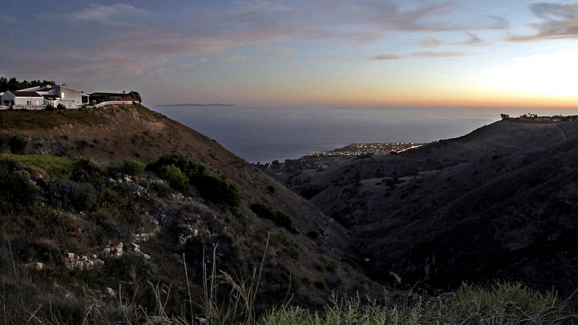 The sun sets on the Pacific Ocean in a view from Del Cerro Park at the southern terminus of Crenshaw Boulevard in the Palos Verdes Peninsula.
