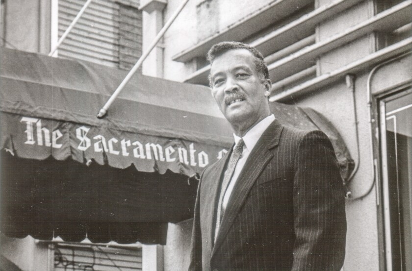 William Lee standing outside the first Sacramento Observer building in 1985.