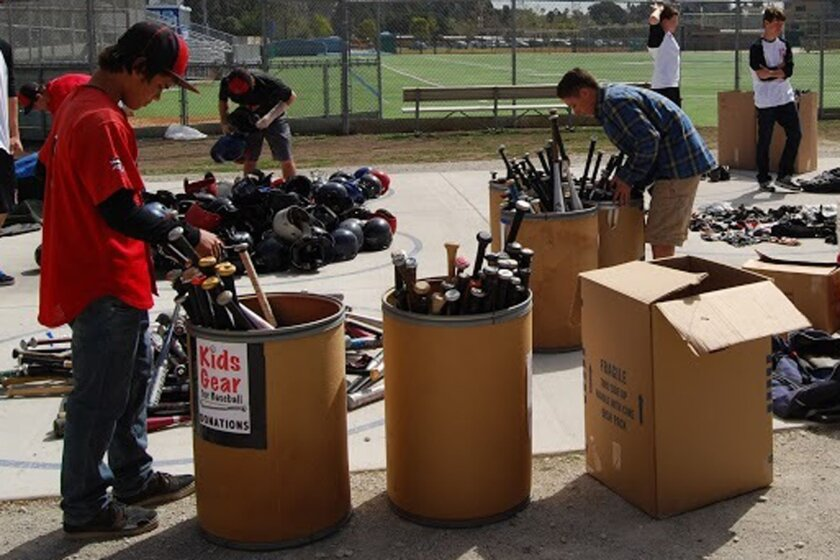 Members of the La Jolla, La Jolla Country Day and Bishop's teams sort collected baseball gear.