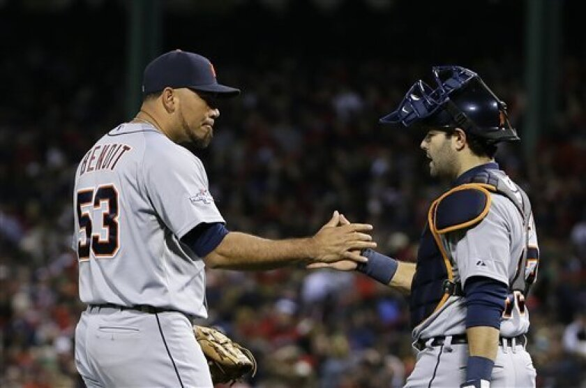 Detroit Tigers catcher Alex Avila, right, congratulates relief pitcher Joaquin Benoit after a 1-0 win against the Boston Red Sox in Game 1 of the American League baseball championship series Sunday, Oct. 13, 2013, in Boston. (AP Photo/Matt Slocum)