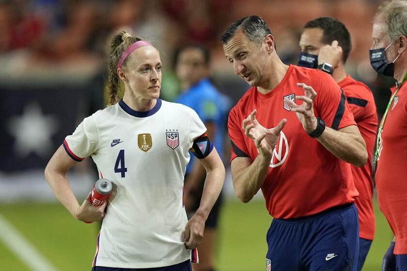 U.S. women's soccer team Coach Vlatko Andonovski, right, talks with Becky Sauerbrunn during a game
