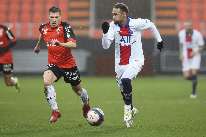 PSG's Neymar, right, challenges for the ball with Lorient's Jonathan Delaplace, during the French League One soccer match between FC Lorient and Paris Saint-Germain at the Moustoir stadium in Lorient, western France, Sunday, Jan. 31, 2021. (AP Photo/David Vincent)