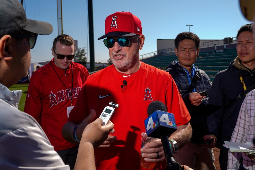 Angels manager Joe Maddon speaks with reporters before practice at Tempe Diablo Stadium on Feb. 17.