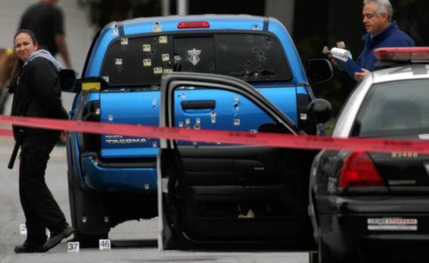 Police officers in pursuit of fugitive ex-cop Christopher Dorner fired on this blue Toyota Tacoma, injuring Margie Carranza, 47, and her mother, Emma Hernandez, 71, who were delivering newspapers in Torrance. The LAPD pledged to provide a new truck to the women, but they still haven't received it.