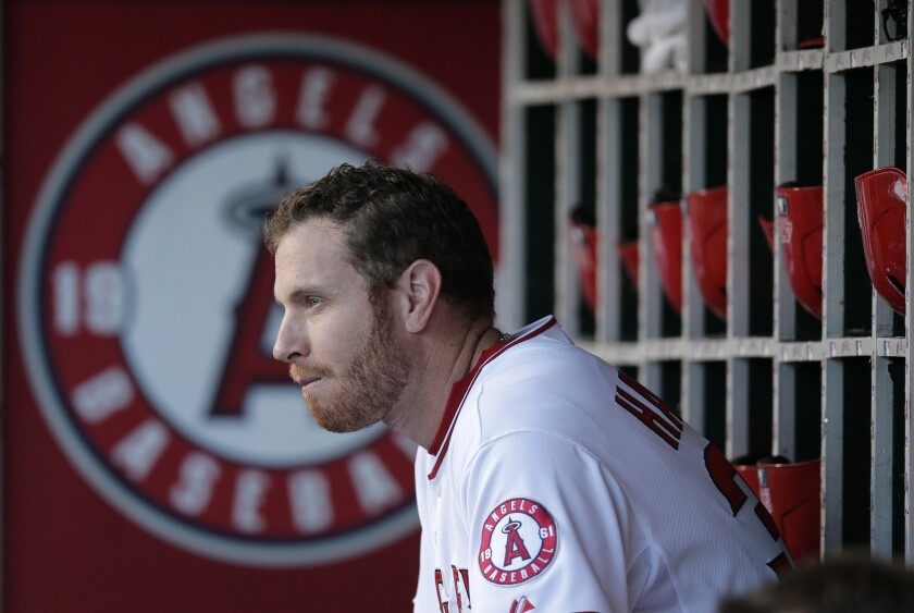 Angels outfielder Josh Hamilton sits in the dugour before a game last season.
