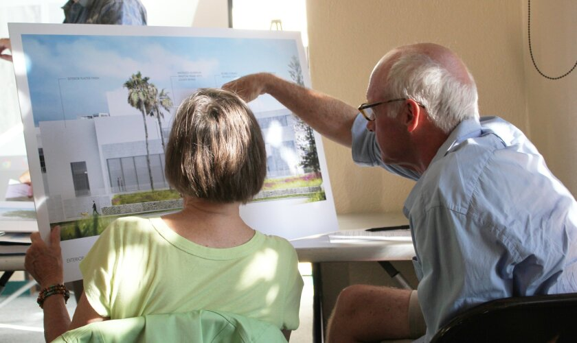 DPR members Diane Kane and Matthew Welsh view renderings of a new gallery wing and ocean-view patio proposed for the Museum of Contemporary Art San Diego, as it would appear from Coast Boulevard.