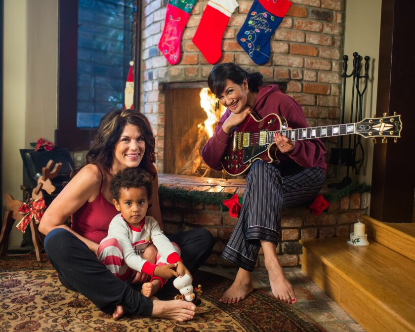 """Partners on stage and off, San Diego musicians Danielle LoPresti (left) and Alicia Champion (right) co-star with their son, Lucian (center), in new video version of """"I Saw Mommy Kissing Santa Claus."""""""