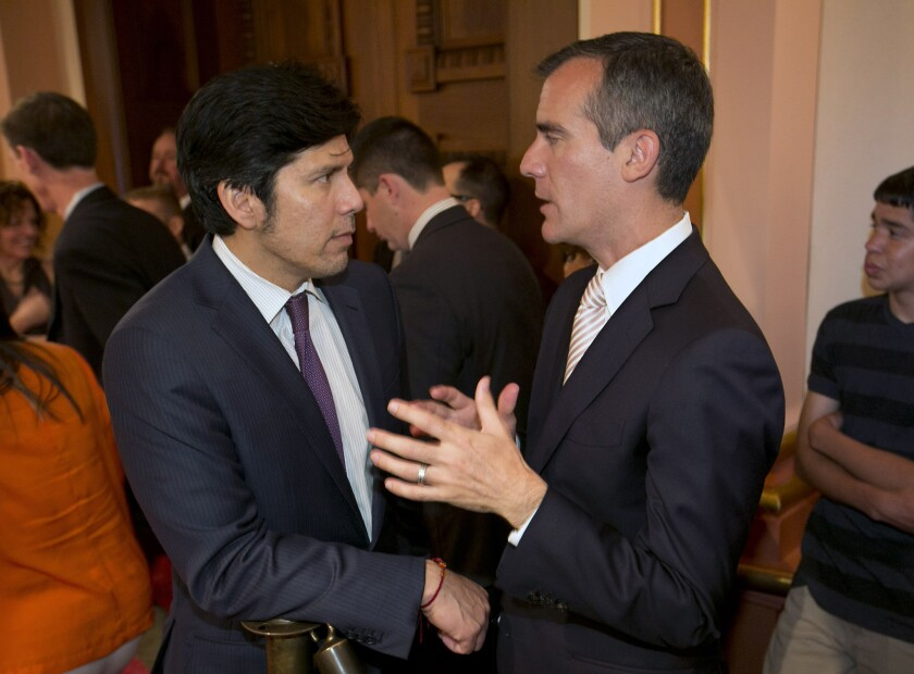 Eric Garcetti, right, and Sen. Kevin de Leon, D-Los Angeles, talk during the L.A. mayor's first official visit to the Capitol in Sacramento on June 5.