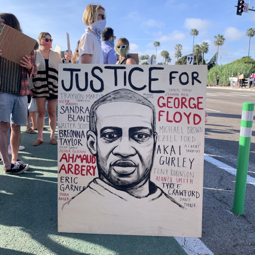 Hundreds gathered for a peaceful protest in Encinitas after the death of George Floyd.