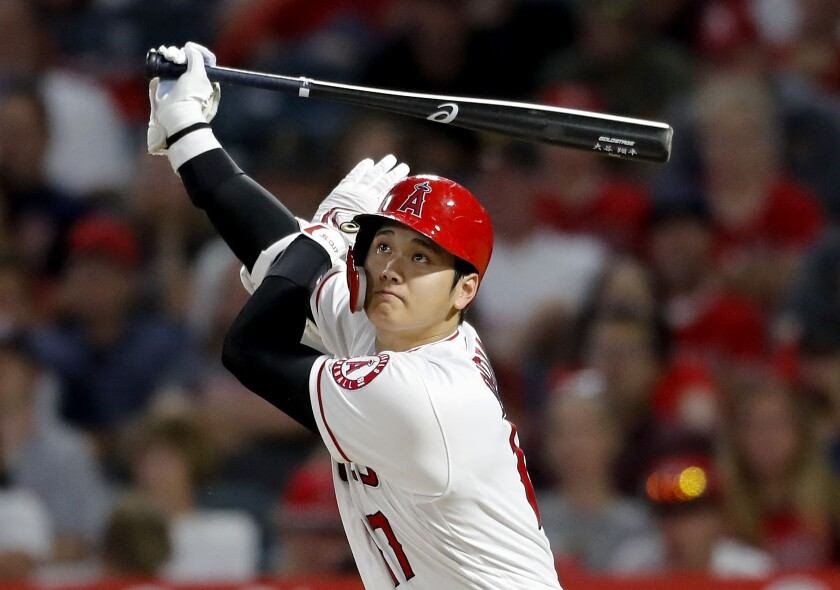 Angels designated hitter Shohei Ohtani hits a triple against the Pirates during a game on Aug. 13 in Anaheim.