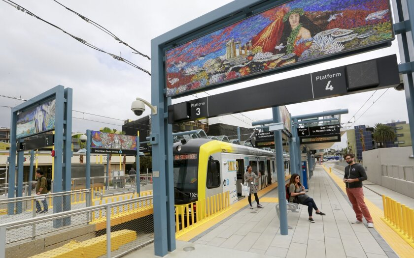 People wait to take a ride on light rail to mark the opening of the 6.6-mile extension of the new Metro Expo Line in Santa Monica, Calif., on Friday, May 20, 2016. For the first time since the 1950s, a Southern California light rail line will extend to the Pacific. The Los Angeles County Metropolitan Transportation Authority says the ride from downtown Los Angeles to Santa Monica will take 48 minutes. That may hardly sound speedy for a 15-mile trip, but the nearly constant congestion of Interstate 10, the usual car route for the trip, can often take just as long or longer. (AP Photo/Damian Dovarganes)