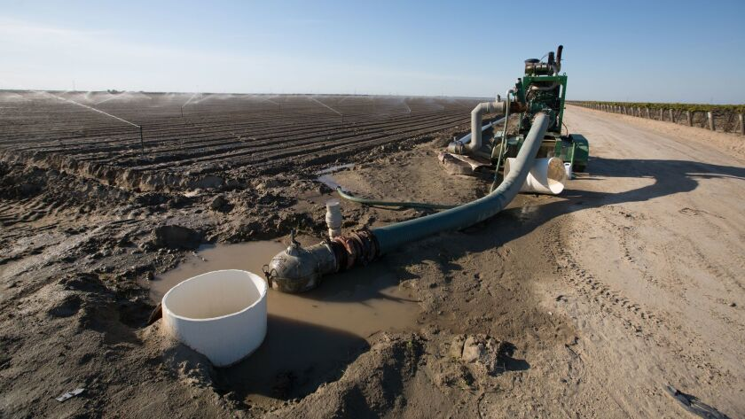 A pump helps to irrigate one of Don Cameron's fields at Terranova Ranch.