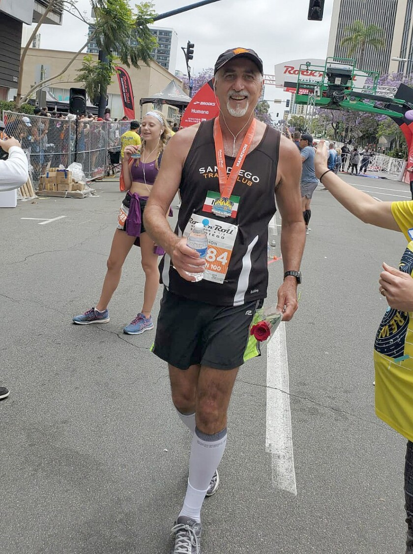 At the conclusion of his 100th career marathon, Ghazinouri was carrying a red rose.<br>