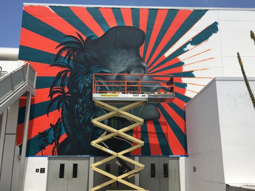 A mural in progress by Beau Stanton.