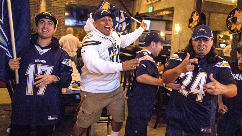 Chargers fans in Los Angeles react after hearing that the team had informed the NFL of plans to relocate from San Diego to L.A.
