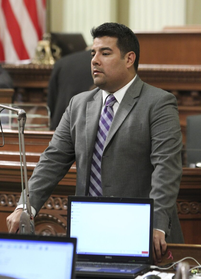 FILE - This Aug. 31, 2011 file photo shows Assemblyman Ricardo Lara, D-Bell Gardens at the Capitol in Sacramento, Calif. Immigrants who are in California illegally should have access to health insurance through a state version of the Affordable Care Act, Lara, the head of the Legislature's Latino c
