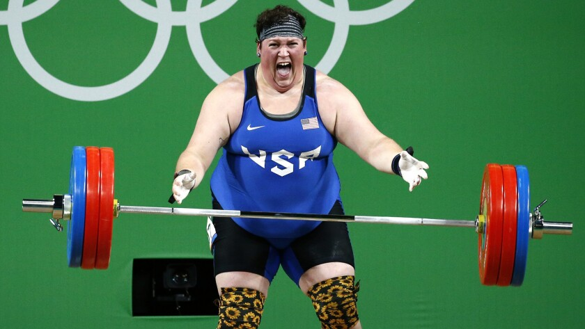 American weightlifter Sarah Robles shows emotion after completing a lift during competition Monday.