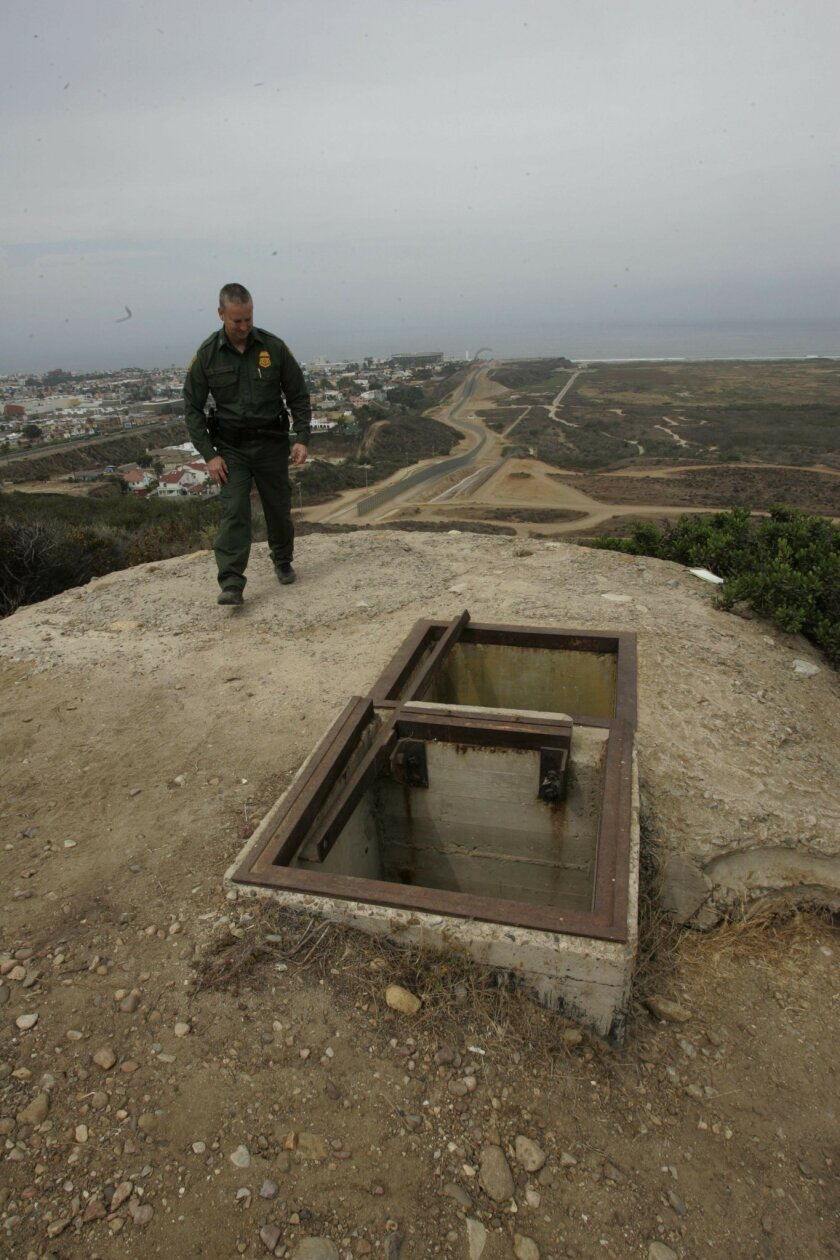 San Diego sector Border Patrol spokesman Richard Gonzales stood atop one of the concrete bunkers that were used during World War II.   John Gibbins / Union-Tribune