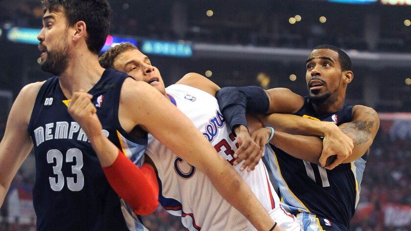 LOS ANGELES, CALIFORNIA APRIL 22, 2013-Clippers Blake Griffin tangles with Grizzlies Marc Gasol, lef