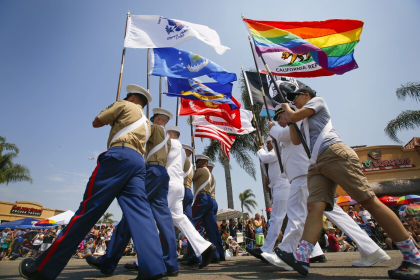 The color guard makes its way along University Avenue in Hillcrest during the 2017 San Diego Pride parade.
