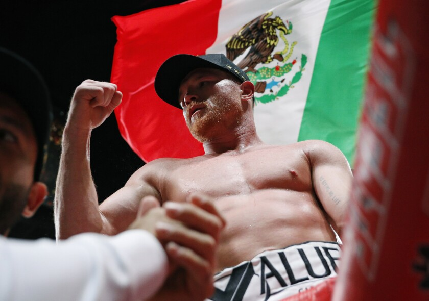 Canelo Alvarez celebrates after defeating Daniel Jacobs in a middleweight title boxing match on May 4 in Las Vegas.