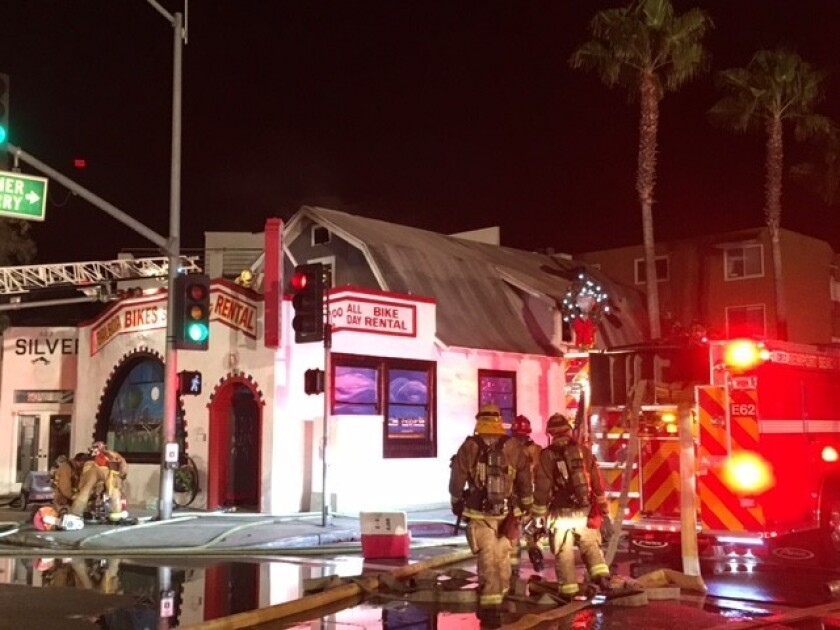 A fire in an apartment above a bicycle shop in Newport Beach caused about $500,000 in damage late Friday, according to authorities.