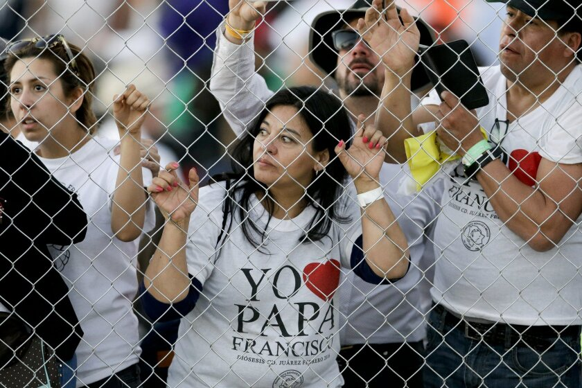 People wait to get a glimpse of Pope Francis as he leaves an outdoor Mass in Ciudad Juarez, Mexico, Wednesday, Feb. 17, 2016. Thousands of people from El Paso as well as other parts of the U.S. were expected to make the short trip over the various bridges that link the cities to attend the outdoor